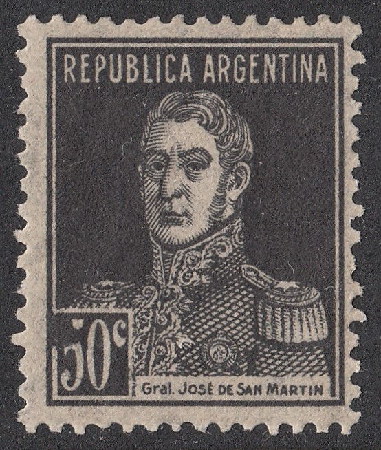 A spot in color of the stamp over denomination