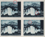 Small white dot nex to the upper frame to the right (the first stamp)