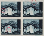 White circle between the waterfalls on the left (the first stamp)