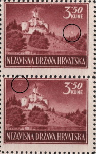 Colored dot above the forest on the right (the upper stamp)
