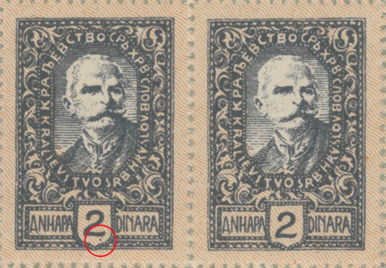 Colored dot below numeral 2 in denomination