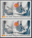 Germany 1988 postage stamp error: White spot below the hand to the left