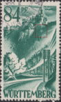 Germany Wuerttemberg postage stamp error:  White spot on hill below the castle.