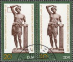 GDR 1983 Amazon statue postage stamp plate flaw Colored dot below Amazon's left elbow.