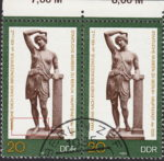 GDR 1983 Amazon statue postage stamp plate flaw Long thin line crossing Amazon's ankles.