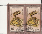 GDR 1983 Sand Glasses and Sundials postage stamp plate flaw Tiny colored spot on the right side of the sundial.