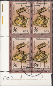 GDR 1983 Sand Glasses and Sundials postage stamp plate flaw White circle touching the left frame, next to letters a and l of Äquatorial.