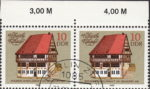 GDR 1983 Old town halls postage stamp plate flaw The third bottom window from the left on white wall damaged at the bottom.